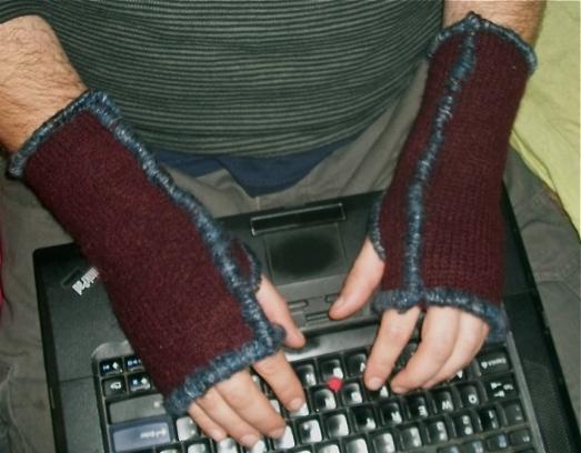 Wool sweater + yarn = fingerless mittens