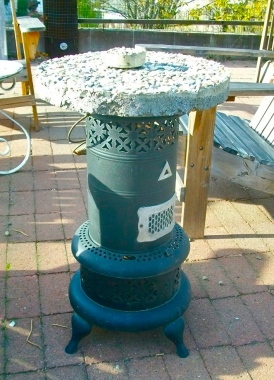 Wood stove + stepping stone = patio table